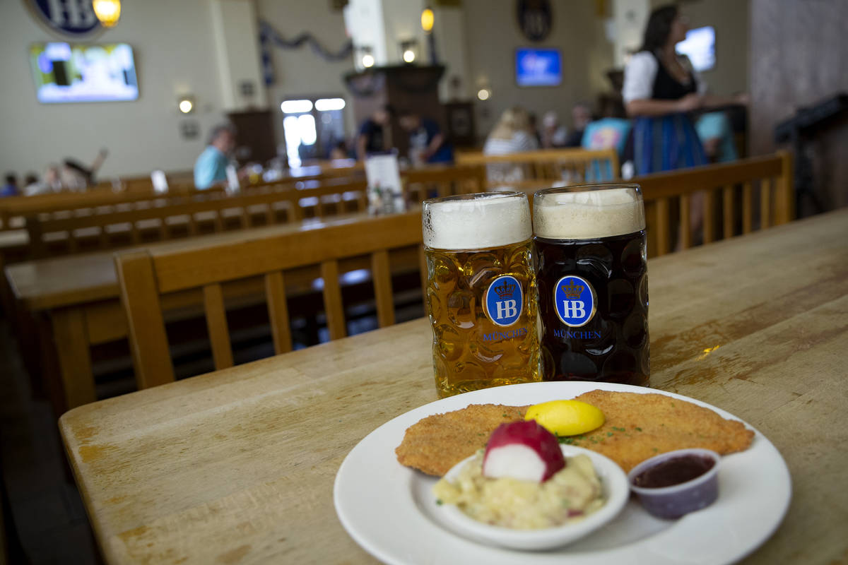 """The """"Schnitzel Wiener Art"""" and two German beers are displayed at Hofbrauhaus on Thurs ..."""