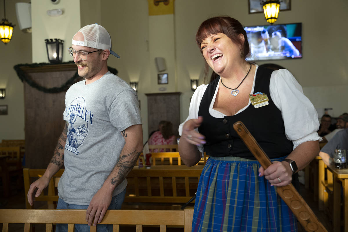 Adam Ross, of Illinois, left, laughs after server Teague Katz gave him a birthday spanking at H ...