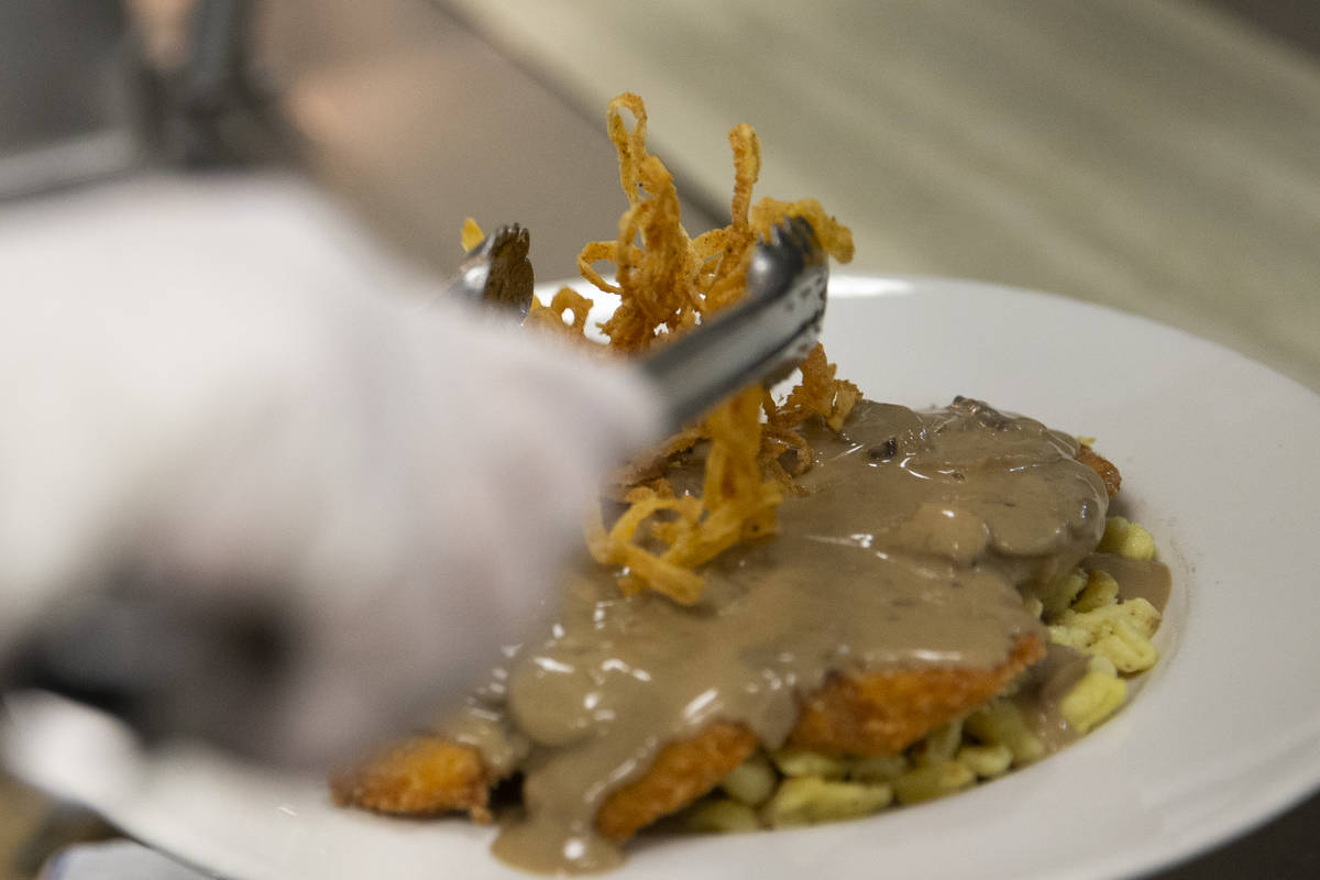 """The """"Gegrillte Hhnchenbrust,"""" chicken in mushroom sauce, is topped with fried onions ..."""