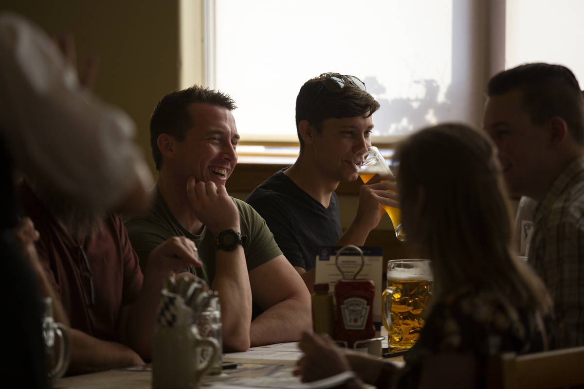 Diners enjoy their beers before ordering traditional German cuisine at Hofbrauhaus on Thursday, ...