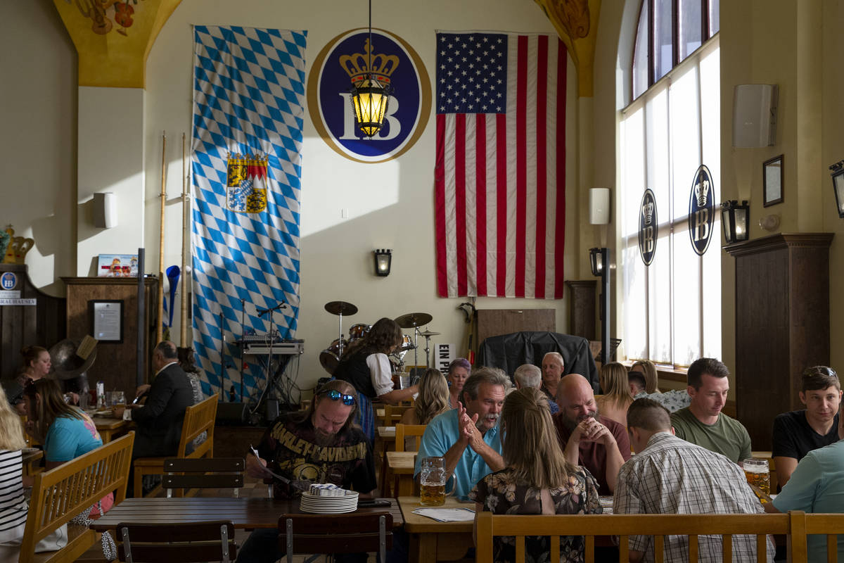 Diners fill traditional German beer hall and restaurant Hofbrauhaus on Thursday, June 17, 2021, ...