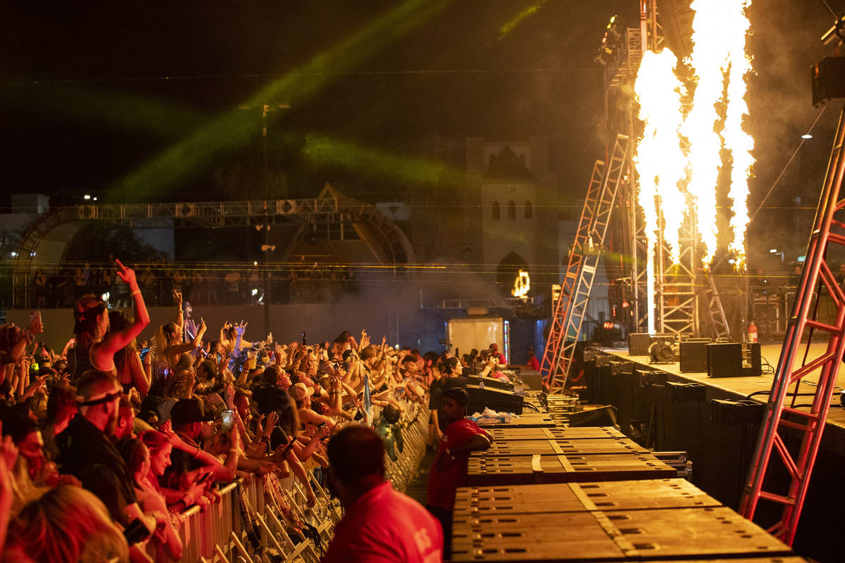 People listen to Excision perform at the Downtown Las Vegas Events Center in Las Vegas, Saturda ...