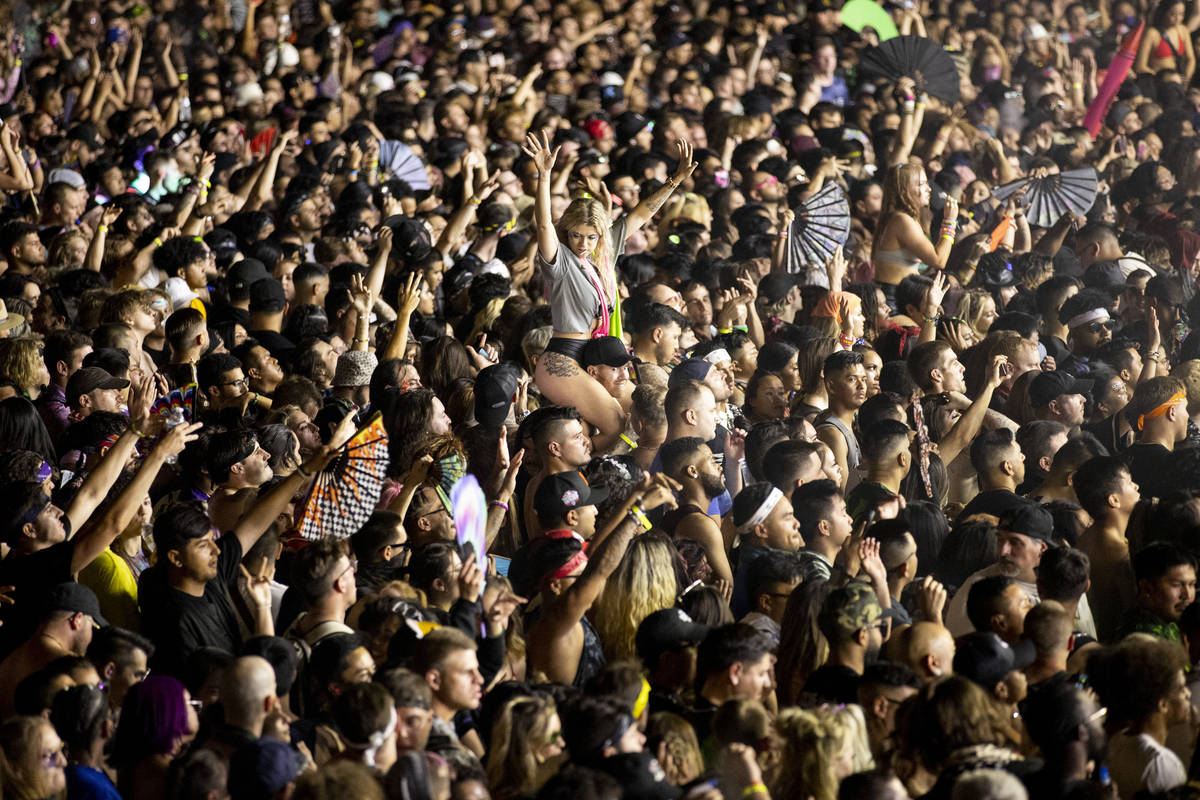 People dance to Excision performing at the Downtown Las Vegas Events Center in Las Vegas, Satur ...