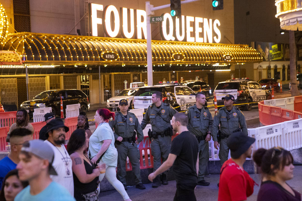 Las Vegas police officers keep watch at the Fremont Street Experience in Las Vegas, Friday, Jul ...