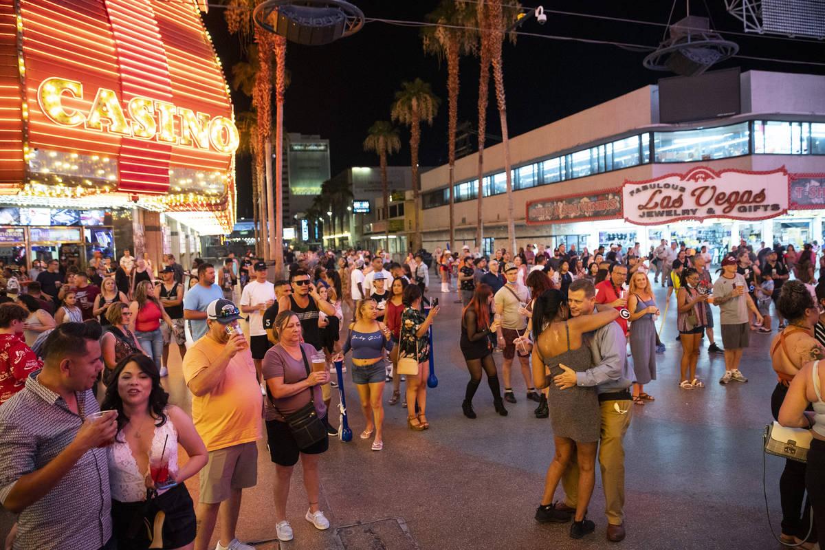 People visit the Fremont Street Experience in Las Vegas, Friday, July 2, 2021. (Erik Verduzco / ...