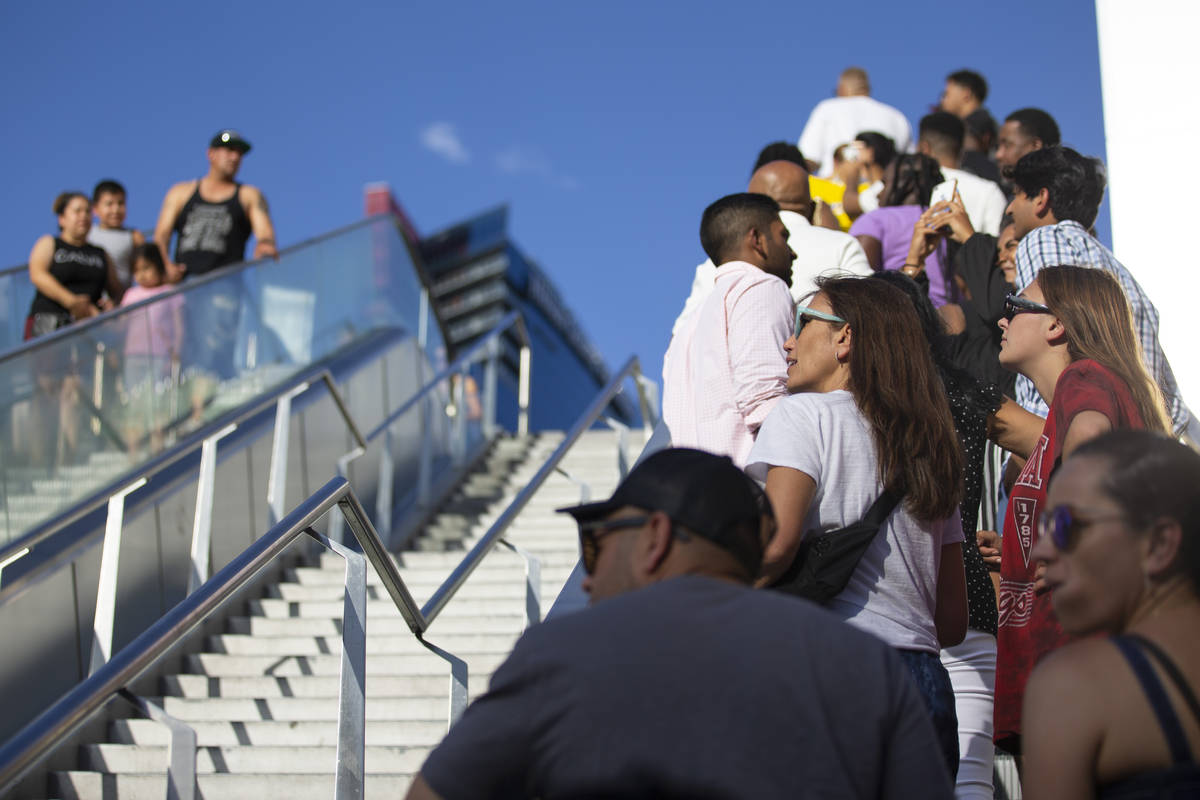 People visit the Strip near Planet Hollywood hotel-casino in Las Vegas, Saturday, July 3, 2021. ...