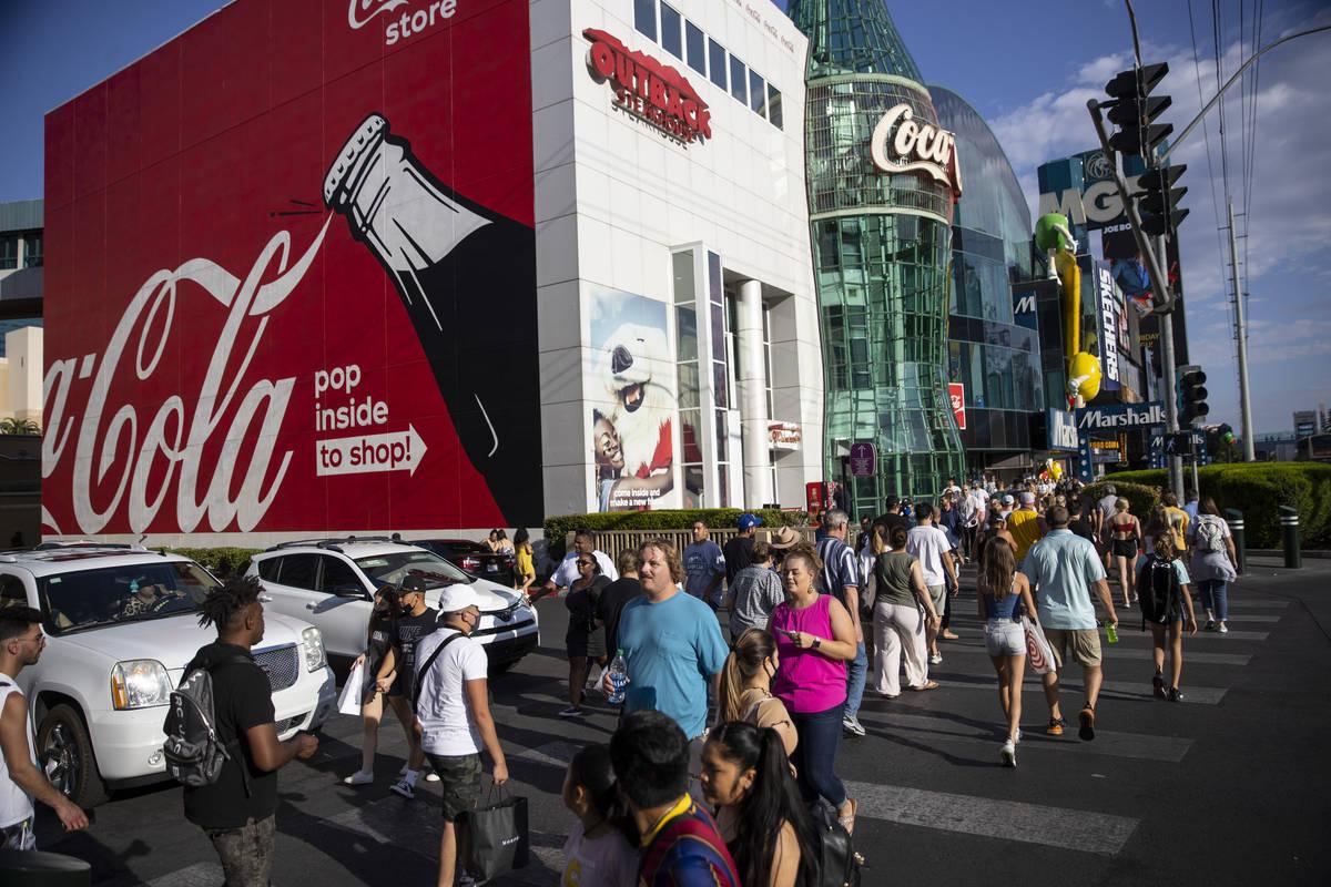 People visit the Strip near MGM Grand hotel-casino in Las Vegas, Saturday, July 3, 2021. (Erik ...
