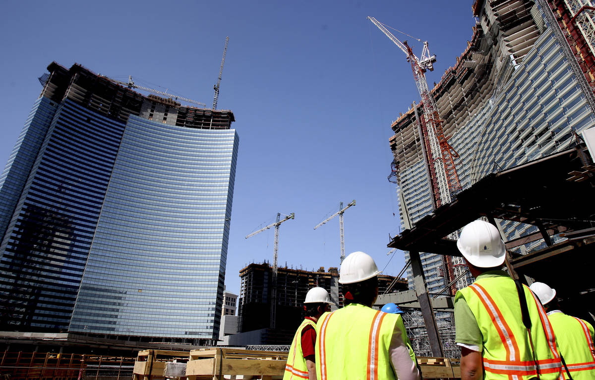 Workers look up at Vdara on the Strip on Thursday, May 8, 2008, in Las Vegas. (Las Vegas Review ...