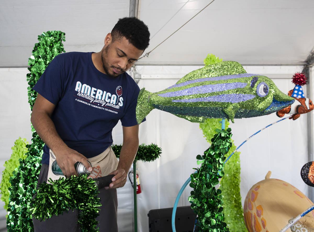 "Dwight Jones, a volunteers, decorates ""Undersea Jubilee"" float for the July 4th S ..."
