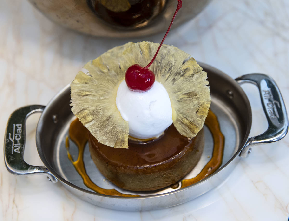 Pineapple upside down cake with a coconut sorbet is displayed at Delilah Supper Club at Wynn, o ...
