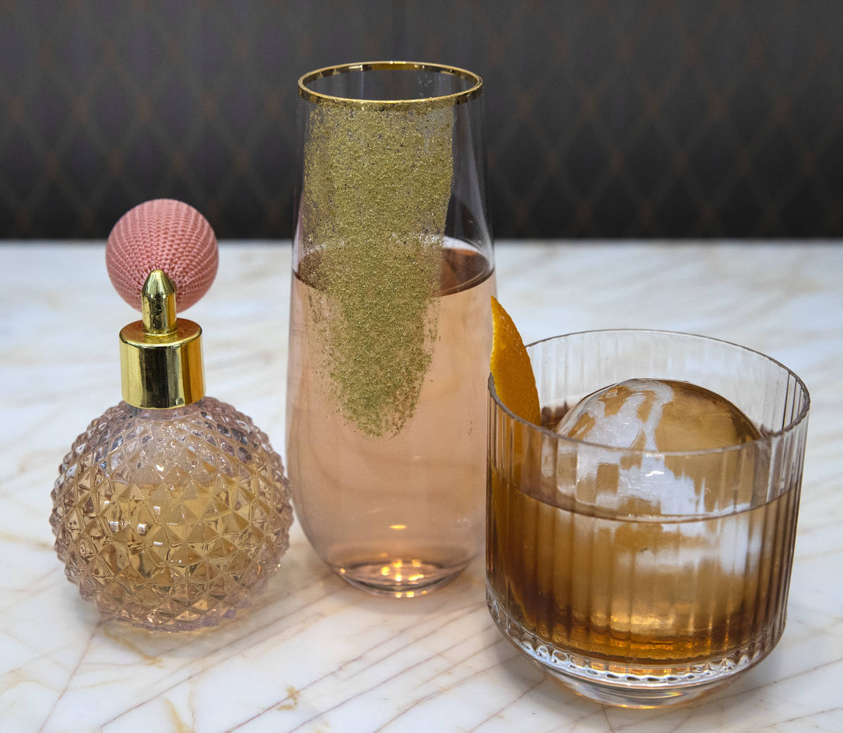 Edible fragrance, left, and cocktail drinks, Stepford Wife, center, Film Noir, right, are displ ...