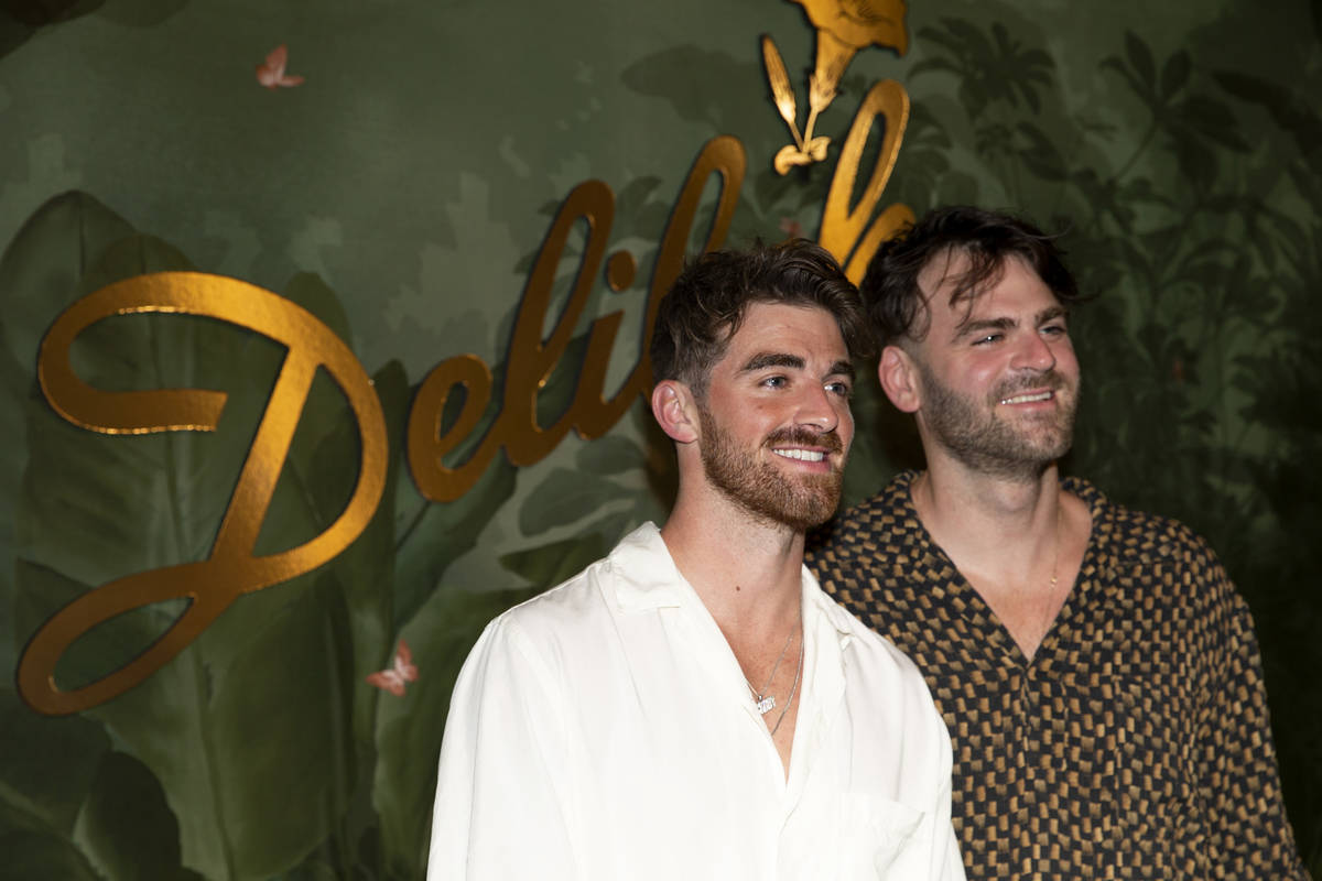 Andrew Taggart, left, and Alex Pall, members of electronic duo The Chainsmokers, pose for photo ...