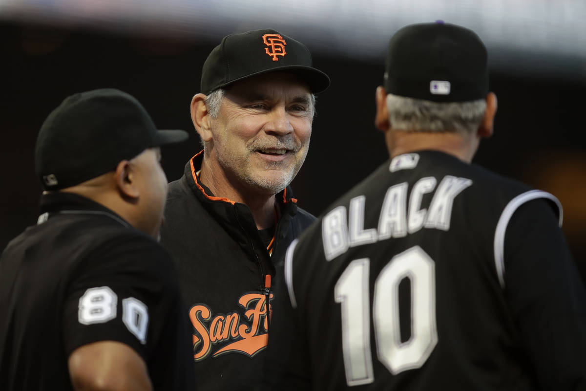 FILE - In this Sept. 24, 2019, file photo, San Francisco Giants manager Bruce Bochy, center, sm ...