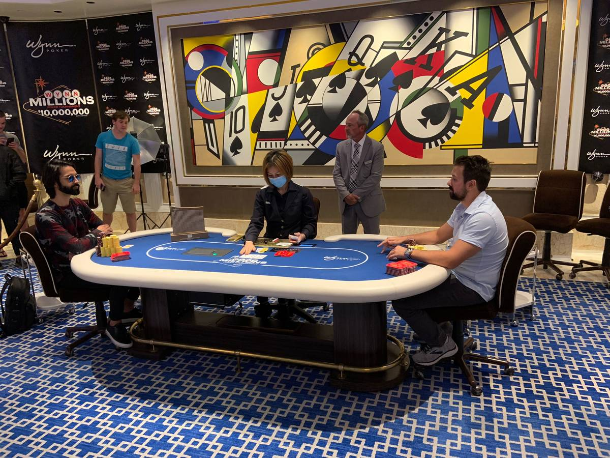 Andrew Moreno, left, and Clayton Maguire play heads-up at the Wynn Millions on Saturday, July 3 ...