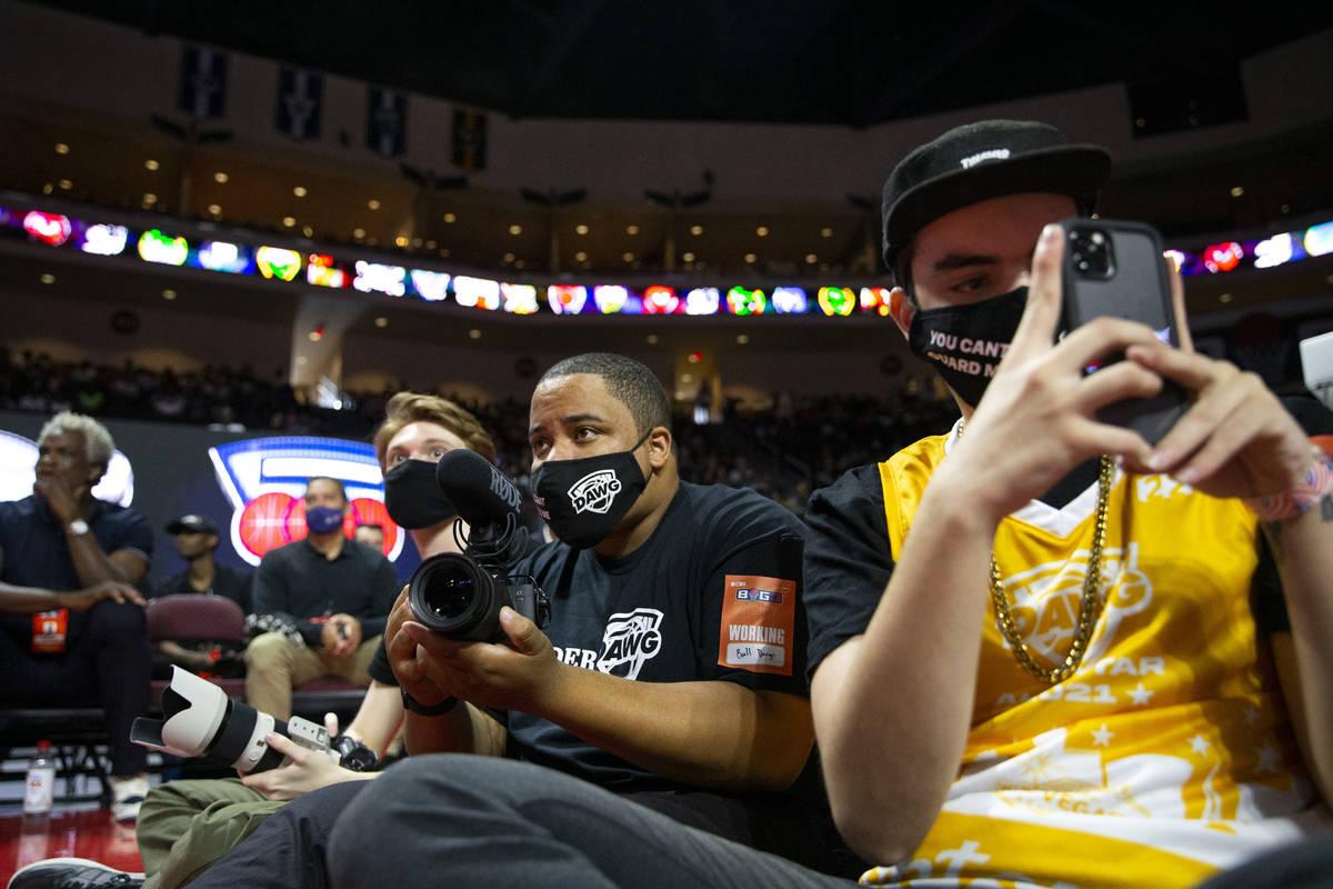 BallDawgs employees Jacob Machnik, left, Malik Ricks and Carter Garife record a BIG3 basketball ...