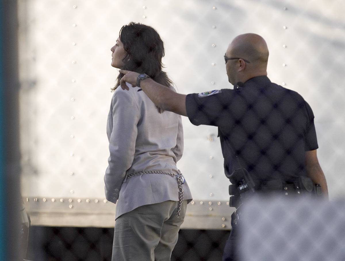 Heather Catherine Tallchief is escorted to the Clark County Detention Center in Las Vegas Thurs ...