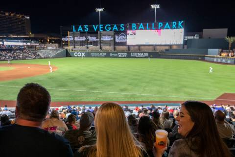 Jamie Lewis, right, laughs with her friend Nettie Byerly, center, during a Las Vegas Aviators g ...