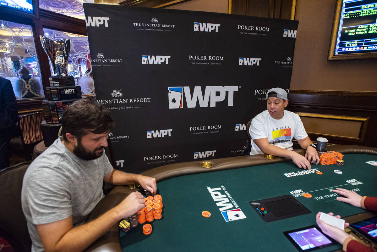 Chad Eveslage, left, plays heads-up against Mike Liang at the final table of a World Poker Tour ...