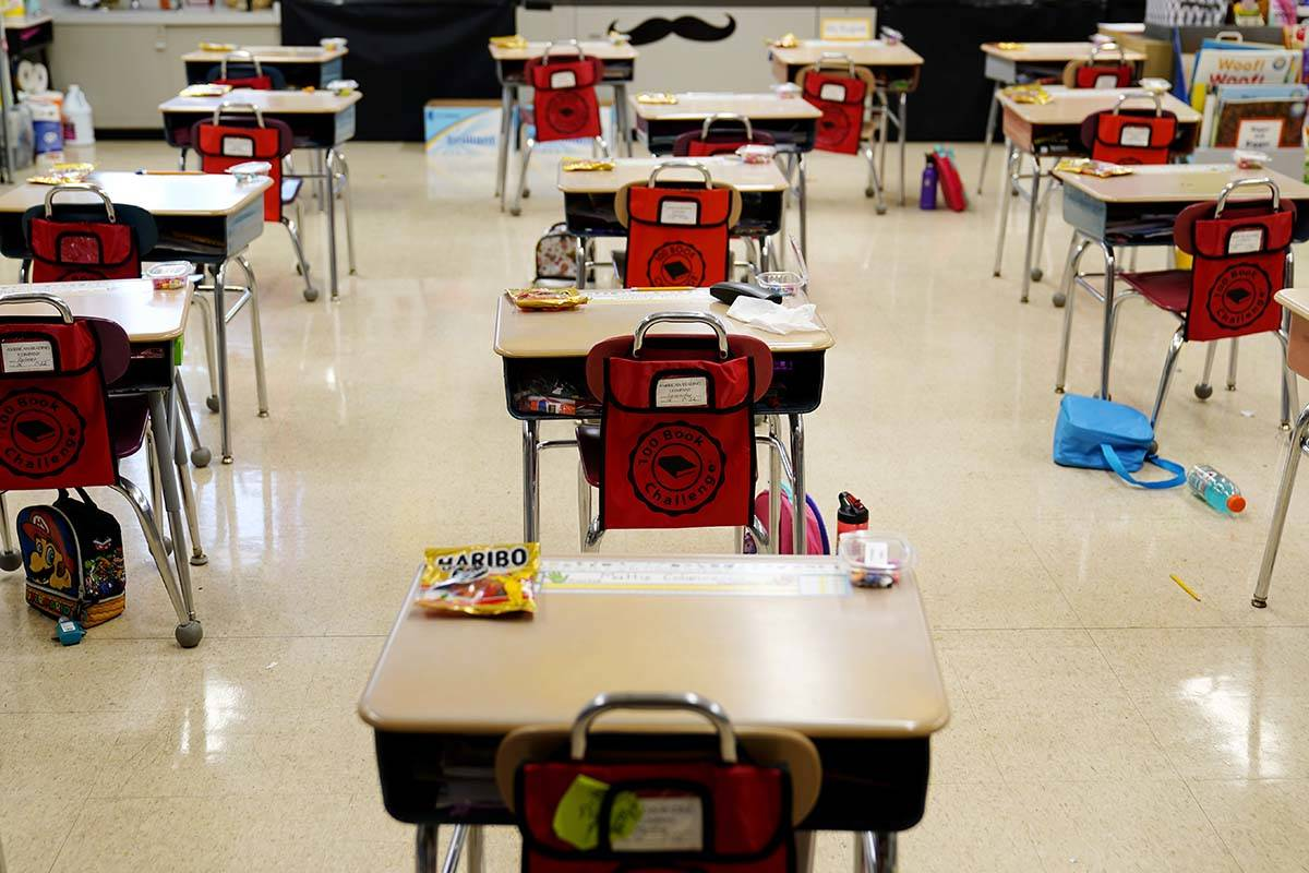 In this Thursday, March 11, 2021 file photo, desks are arranged in a classroom at an elementary ...