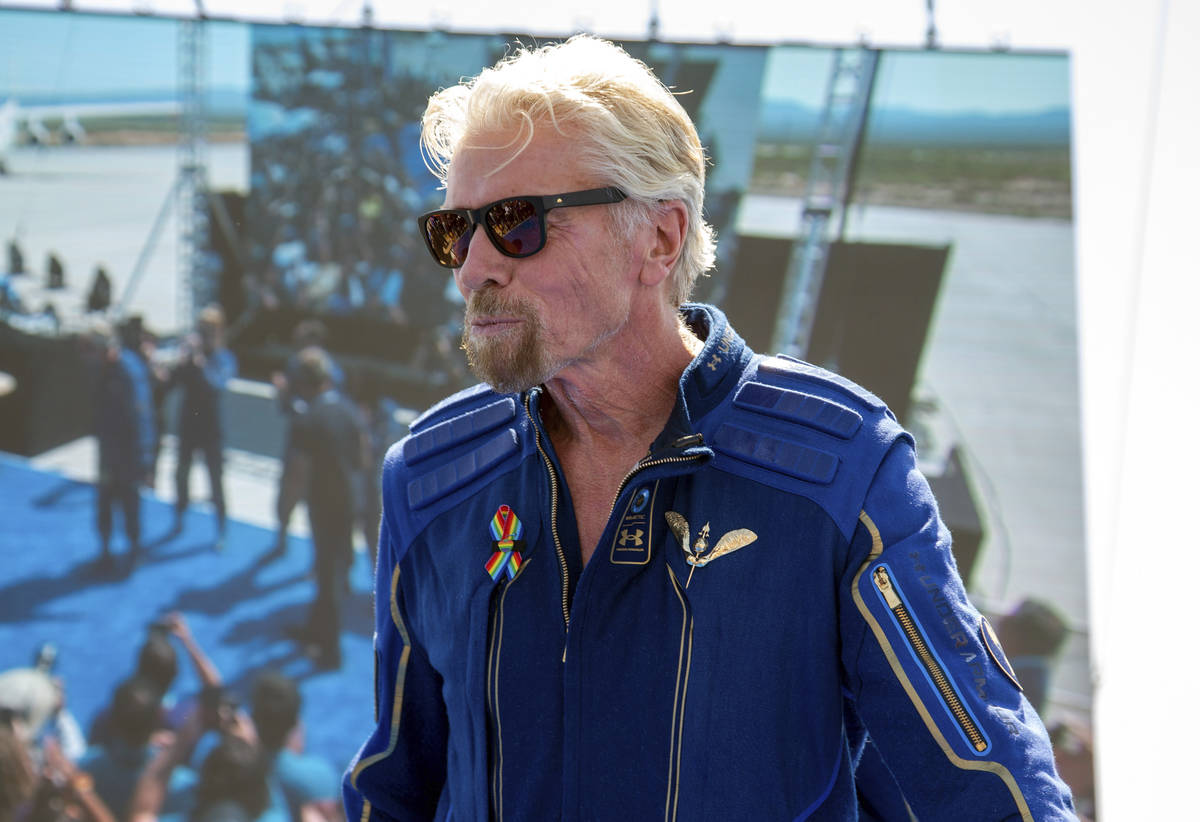 Virgin Galactic founder Richard Branson shows his astronaut wings pin after his flight to space ...