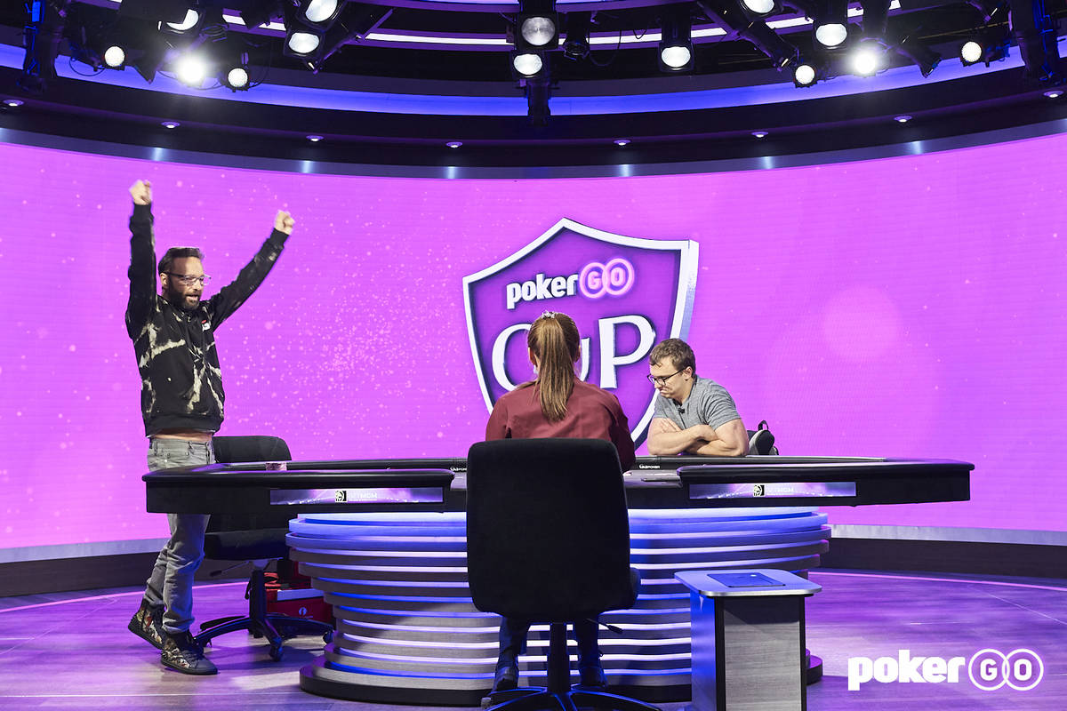Daniel Negreanu, left, reacts after beating David Coleman heads-up to win the $50,000 buy-in ev ...