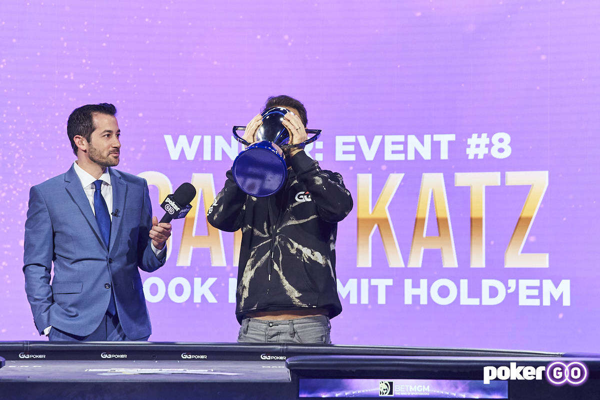 Daniel Negreanu drinks a beer from his trophy after winning the overall PokerGO Cup series titl ...