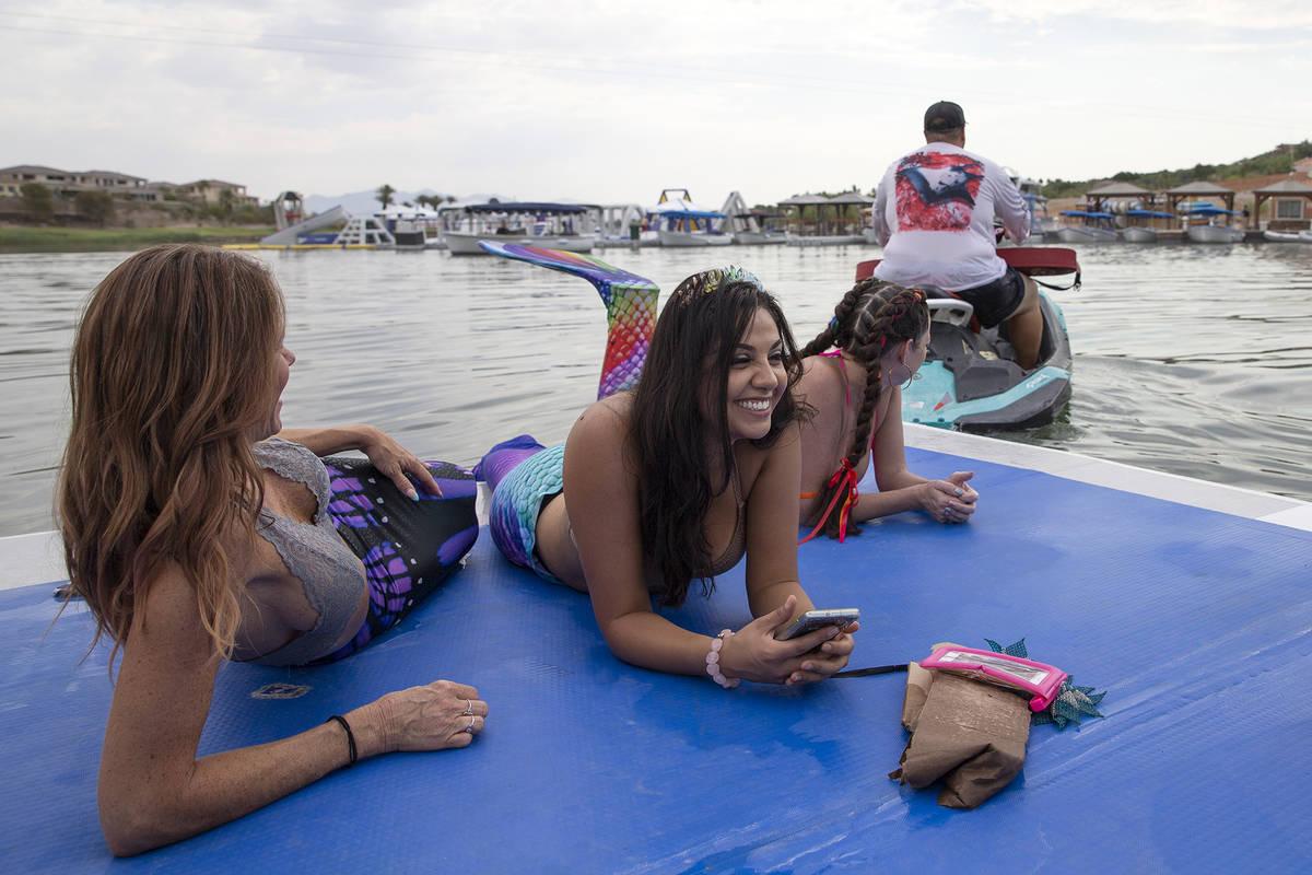 Mermaids are towed in on a raft at Lake Las Vegas on Saturday, June 19, 2021, in Henderson. (El ...