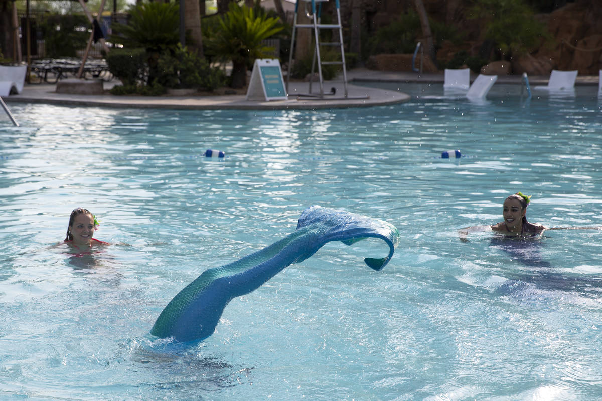 Mermaid CaySea -- Casey McConachie -- left, and Mermaid Luna -- Jamie Rivera -- right, watch as ...