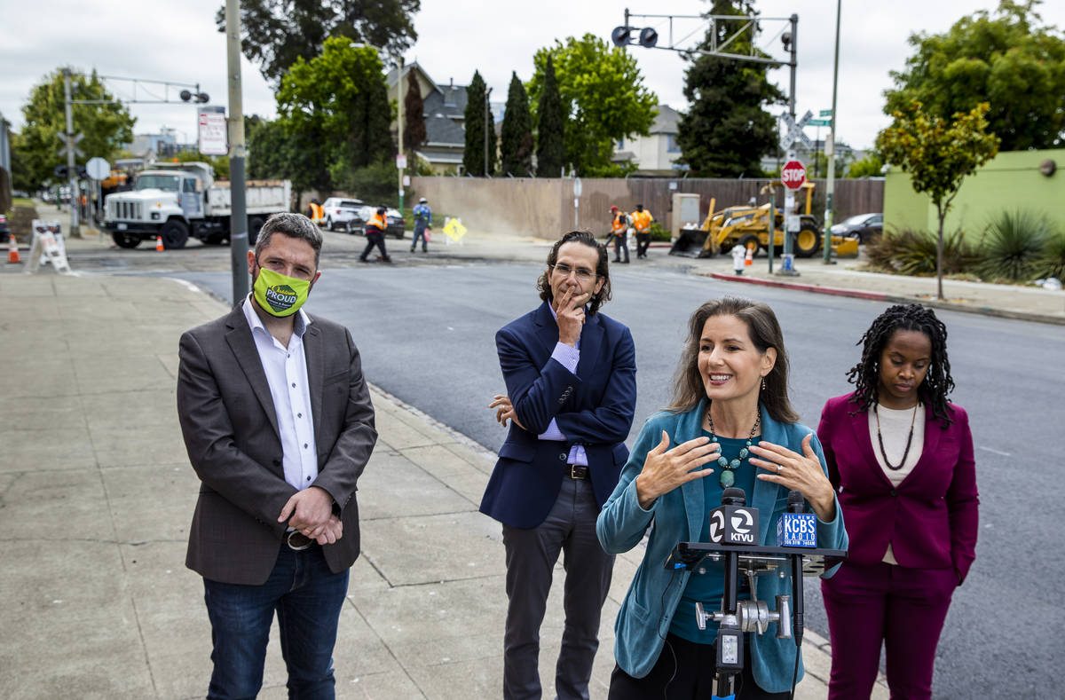 Oakland Mayor Libby Schaaf, right center, speaks at a press conference on Friday, July 2, 2021, ...