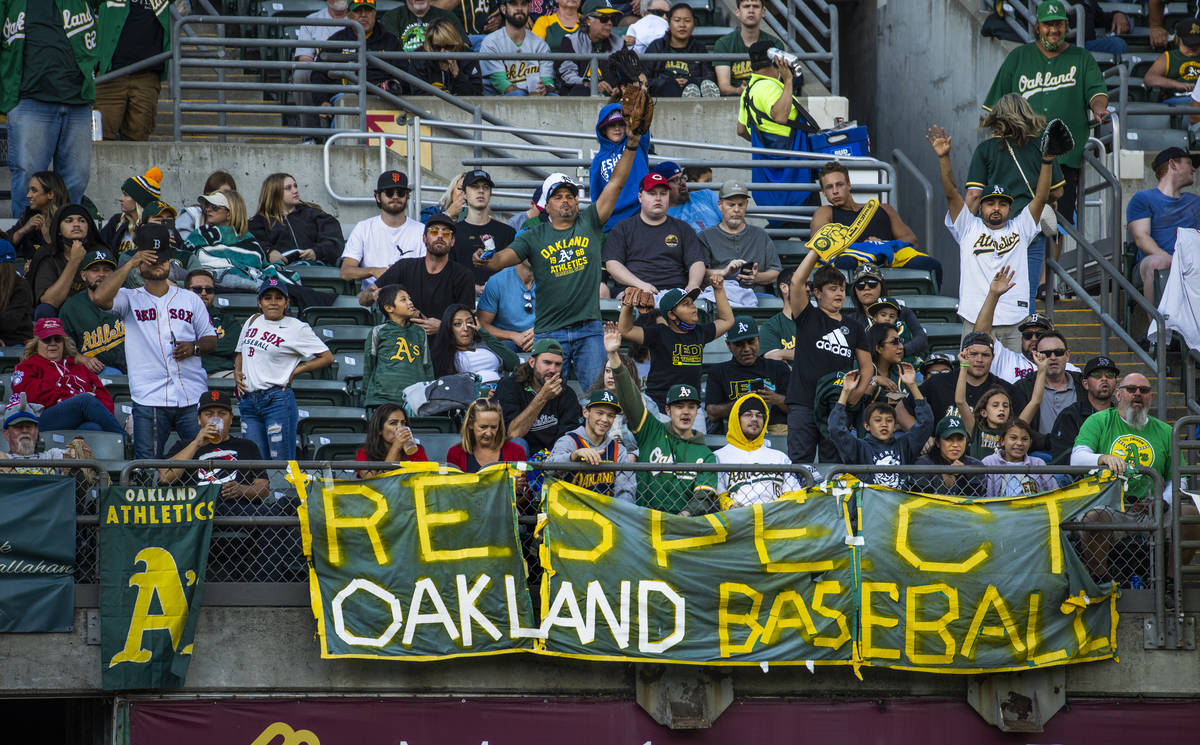 Oakland A's fans cheer for their team as they play the Boston Red Sox at RingCentral Coliseum ...