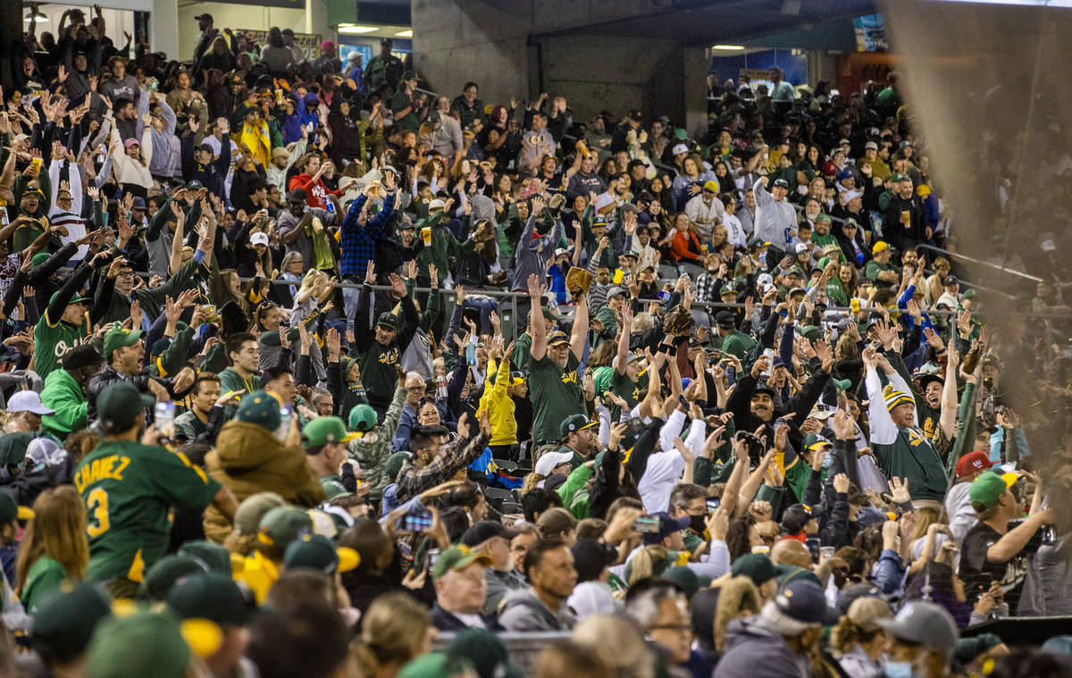 """Oakland A's fans do the """"wave"""" during the game against the Boston Red Sox at RingCentral Coli ..."""
