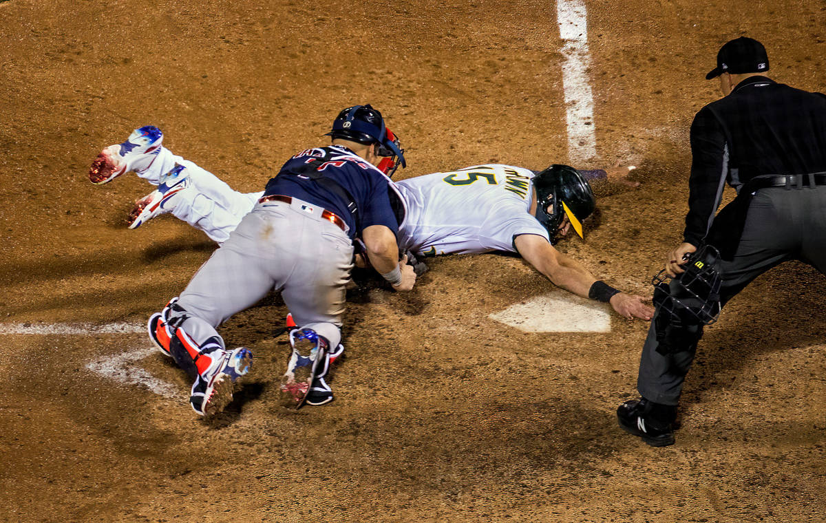 Boston Red Sox catcher Christian Vazquez (7) tags out Oakland A's runner Seth Brown (15) at h ...