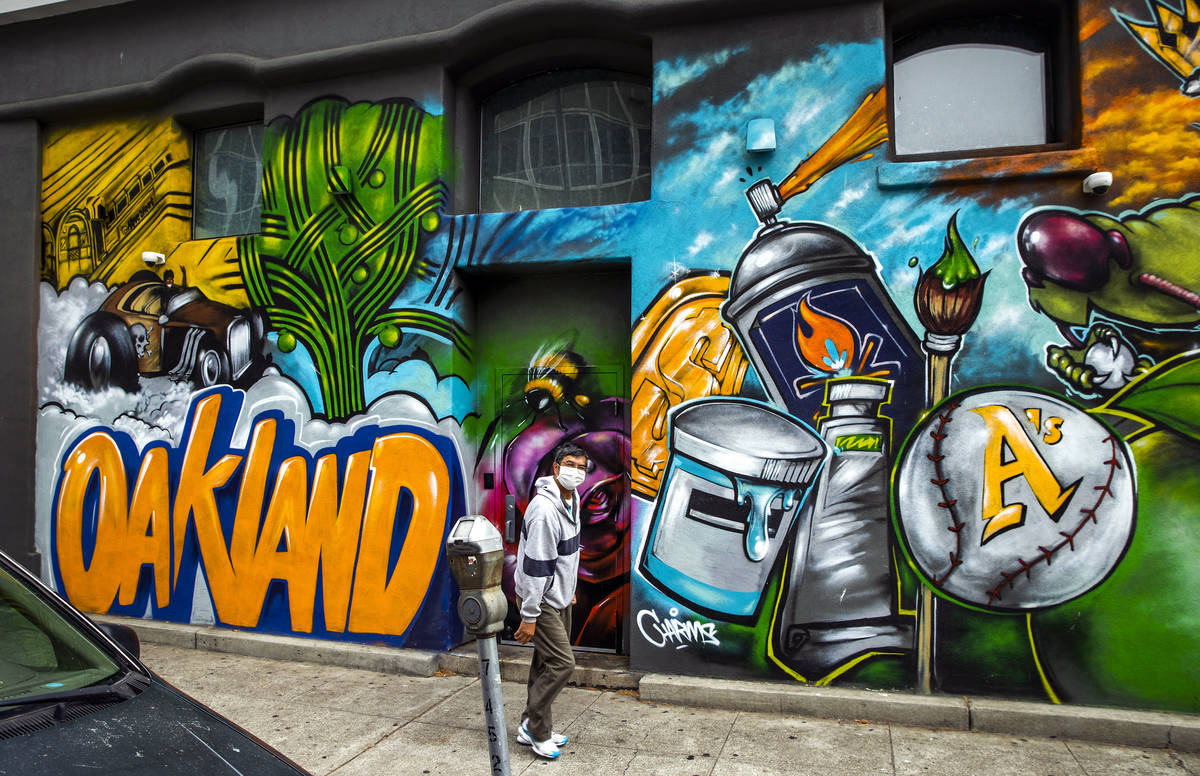 The Oakland A's are featured as part of a mural in the Chinatown neighborhood on Saturda ...