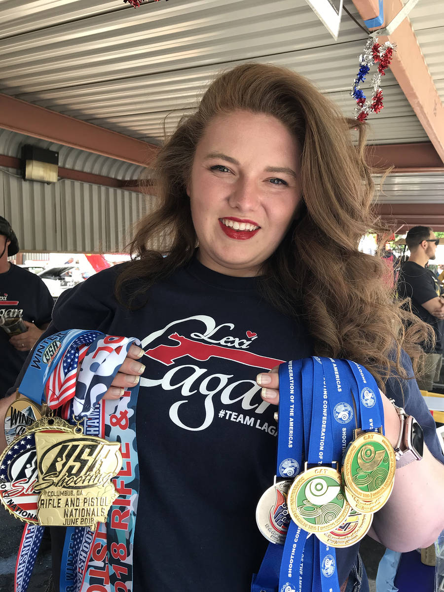 Alexis Lagan of Boulder City shows off the medals she has won competing in shooting events. She ...