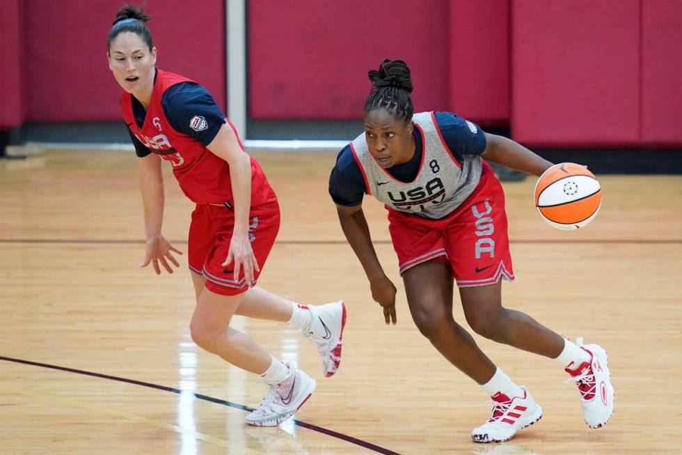 Chelsea Gray drives around Sue Bird during practice for the U.S women's basketball team in prep ...