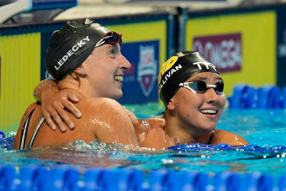 Katie Ledecky hugs Erica Sullivan after winning the women's 1500 freestyle during wave 2 of the ...