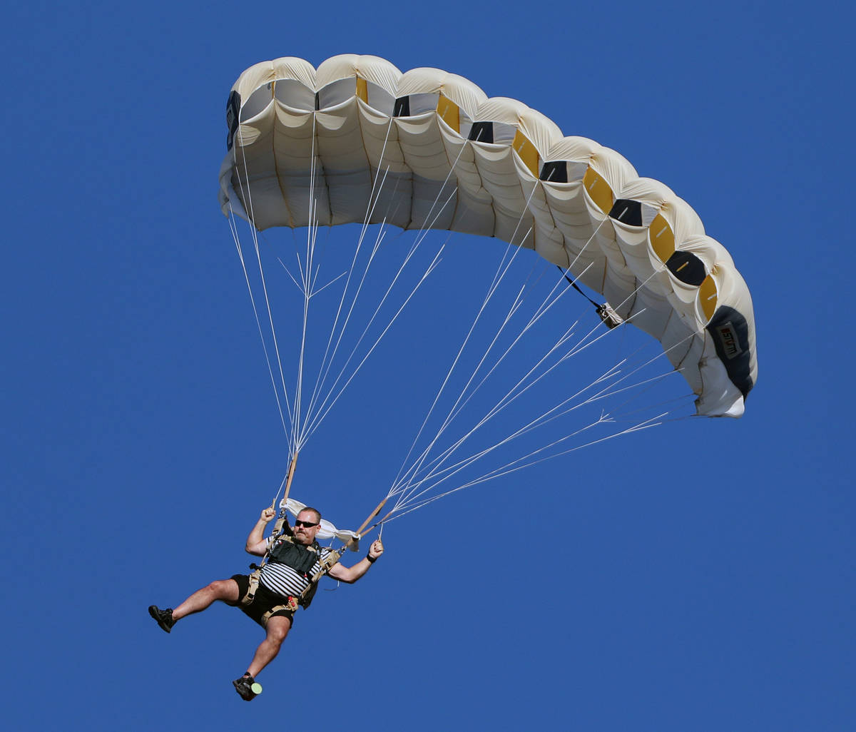 Skydivers descend for Marché Bacchus' Bastille Day celebration in front of the restaurant's gu ...
