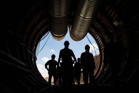 Members of a congressional tour make their way through the south portal of Yucca Mountain in 20 ...