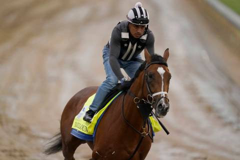 Kentucky Derby entrant Mandaloun works out at Churchill Downs Thursday, April 29, 2021, in Loui ...