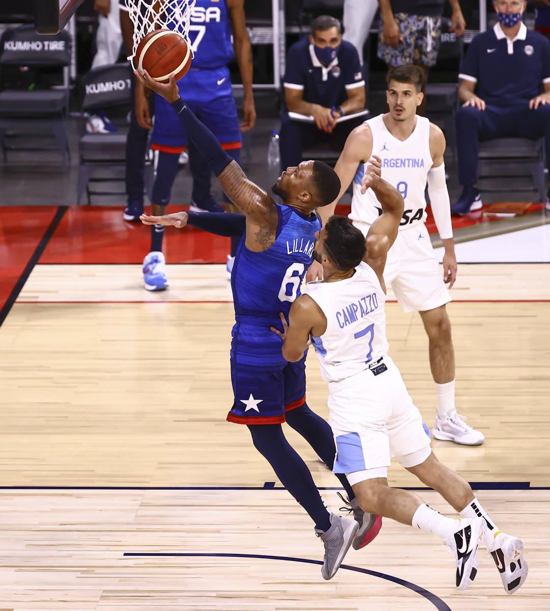 USAÕs Damian Lillard (6) goes to the basket past ArgentinaÕs Facundo Campazzo (7) dur ...