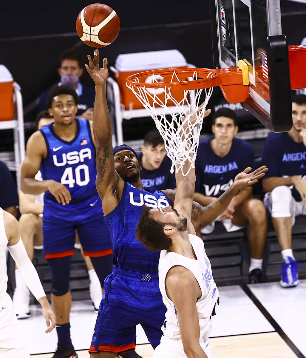 USA's Bradley Beal (4) shoots around Argentina's Marcos Delia (12) during the sec ...
