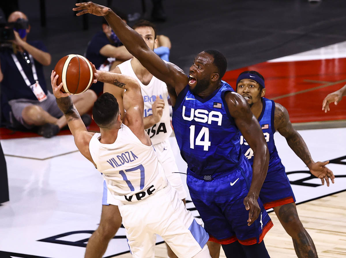 Argentina's Luca Vildoza (17) looks to pass as USA's Draymond Green (14) defends ...