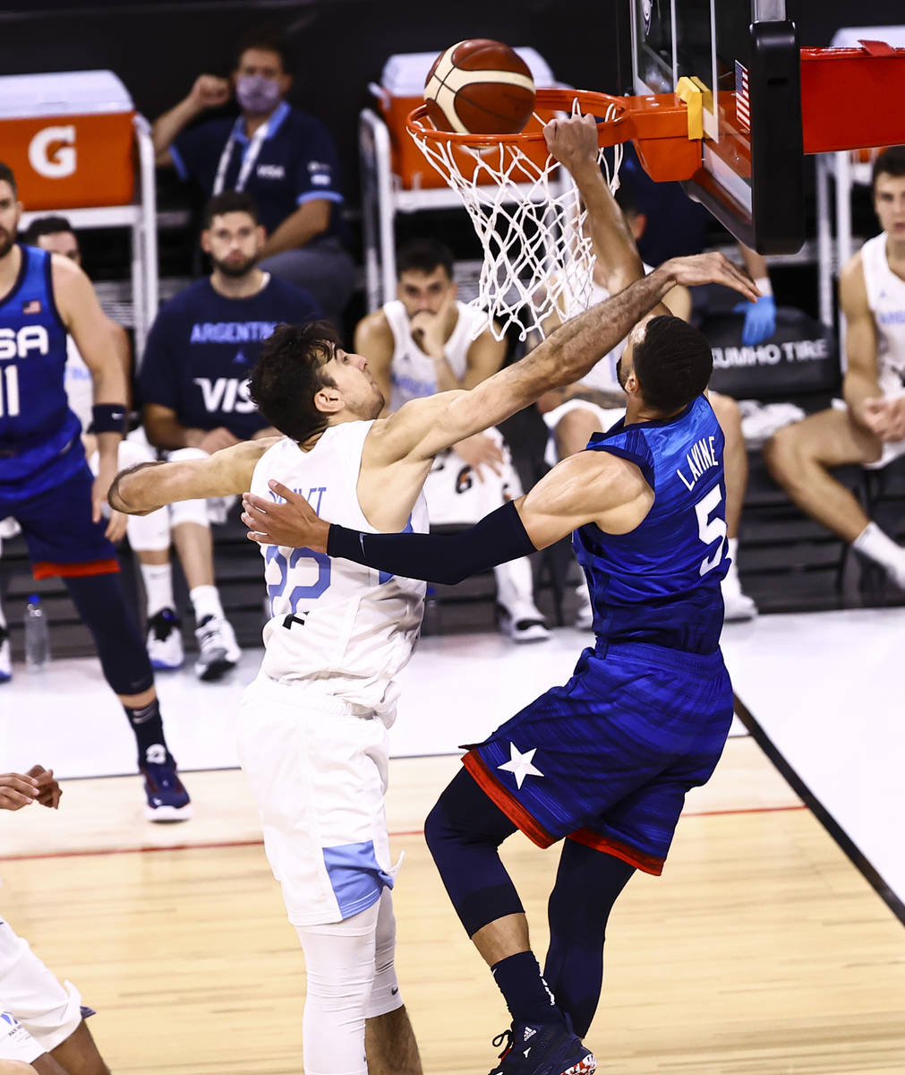 USAÕs Zach Lavine (5) dunks the ball while being fouled by ArgentinaÕs Juan Pablo Vau ...