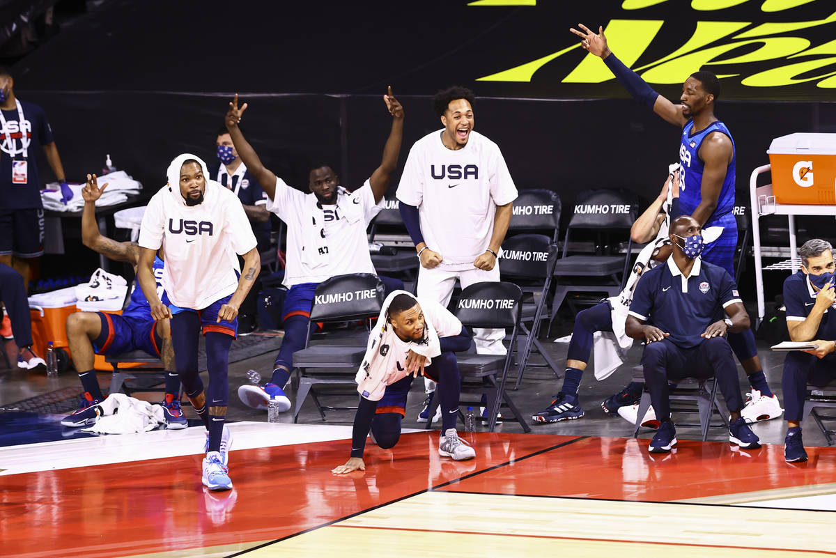 USA players celebrate during the second half of an exhibition basketball game against Argentina ...