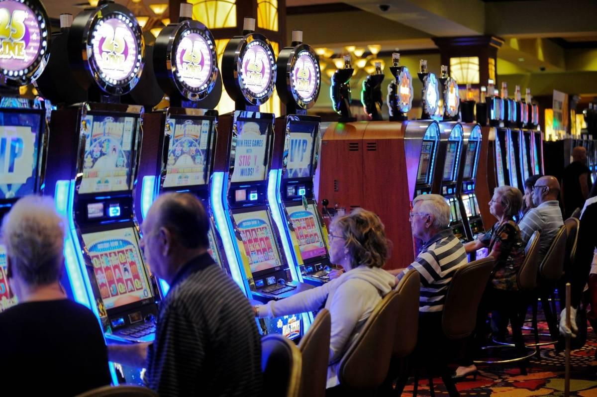Players enjoy slot machines at Seminole Casino Coconut Creek in Florida in February 2012. (Josh ...