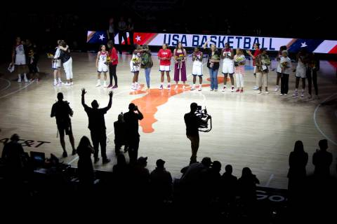 Current players present bouquets of flowers to members of the 1996 Olympic women's basketball t ...