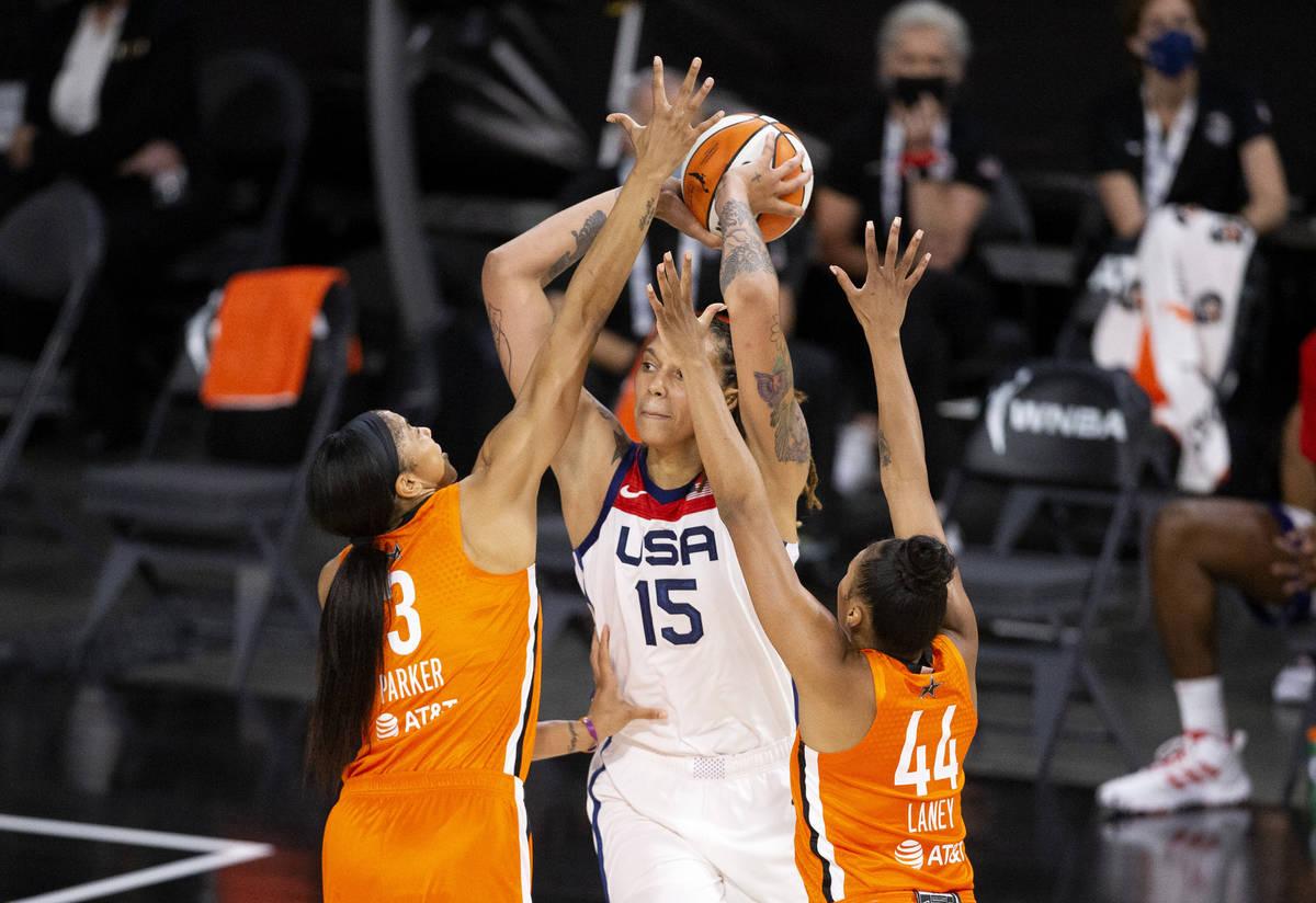 Team WNBA's Candace Parker (3) and Betnijah Laney (44) guard U.S. Women's National Team's Britt ...