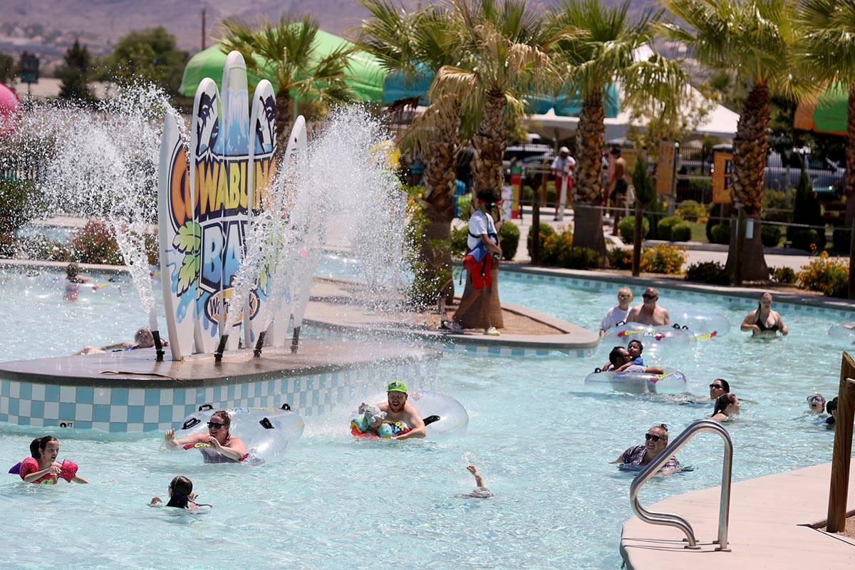 Boardwalk Bay, left, and the Cowabunga River at the reopening of Cowabunga Bay water park in He ...