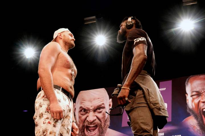 WBC Heavyweight Champion Tyson Fury, left and Deontay Wilder face off at a news conference in L ...