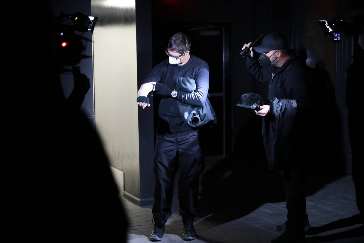 Zak Bagans examines his arm after feeling an unusual sensation during their investigation. (Dis ...